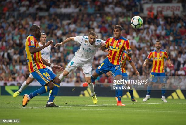 Karim Benzema of Real Madrid CF heads the ball beside Jeison Murillo of Valencia CFduring the La Liga match between Real Madrid CF and Valencia CF at...