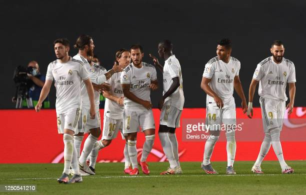 Karim Benzema of Real Madrid CF is congratulated by team mate Eden Hazard after scoring the opening goal during the Liga match between Real Madrid CF...