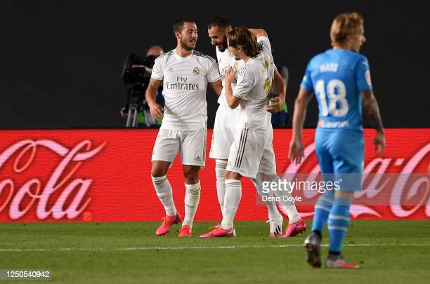 Karim Benzema of Real Madrid CF is congratulated by team mates Eden Hazard and Luka Modrić after scoring the opening goal during the Liga match...