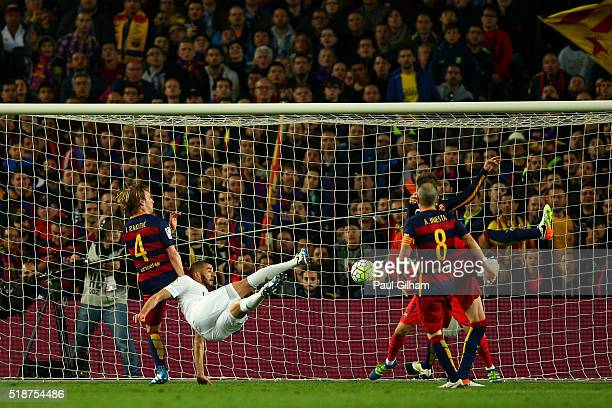 Karim Benzema of Real Madrid CF scores his team's first goal during the La Liga match between FC Barcelona and Real Madrid CF at Camp Nou on April 2...