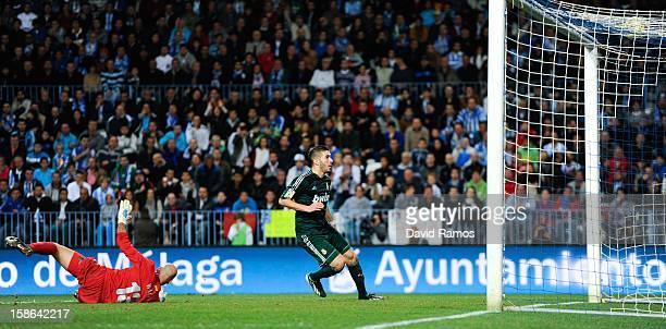 Karim Benzema of Real Madrid CF scores his team's second goal during the La Liga match between Malaga CF and Real Madrid CF at La Rosaleda Stadium on...