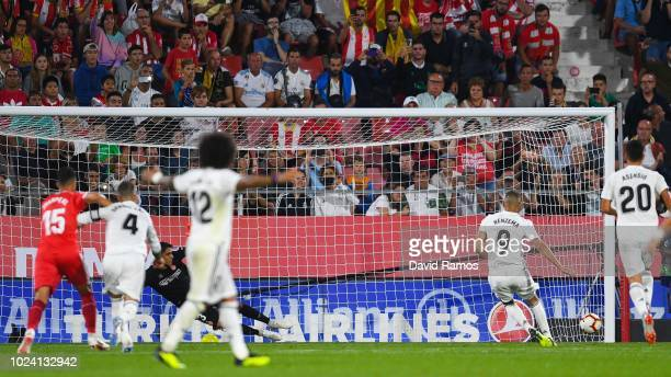Karim Benzema of Real Madrid CF scores his team's second goal from the penalty spot during the La Liga match between Girona FC and Real Madrid CF at...