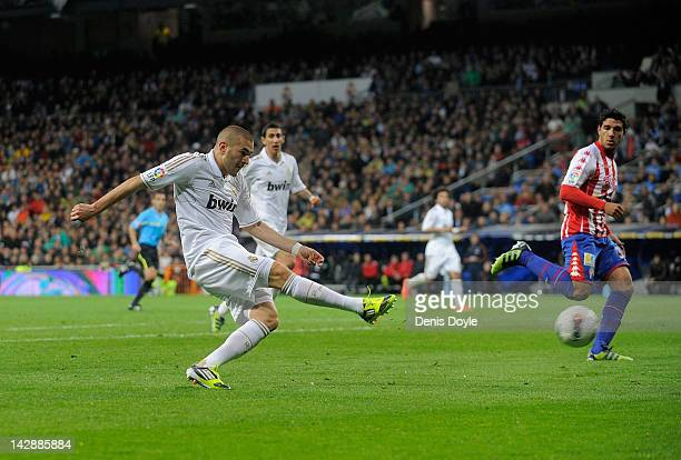 Karim Benzema of Real Madrid CF scores Real's 3rd goal during the La Liga match between Real Madrid CF and Real Sporting de Gijon at Estadio Santiago...