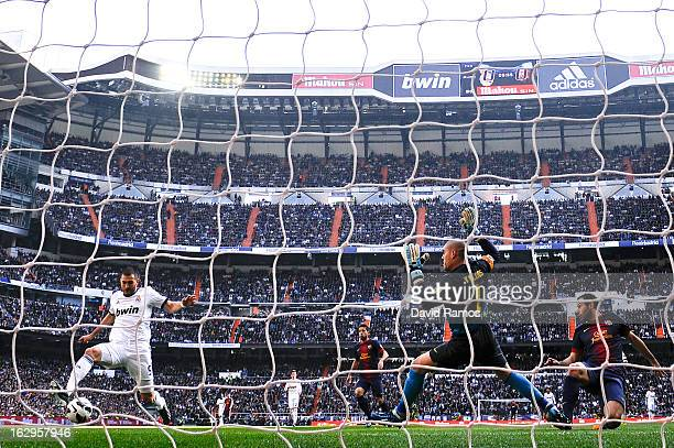 Karim Benzema of Real Madrid CF scores the opening goal during the La Liga match between Real Madrid CF and FC Barcelona at Bernabeu on March 2 2013...