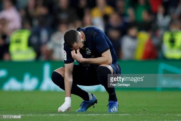 Karim Benzema of Real Madrid CF shows his dejection during the Liga match between Real Betis Balompie and Real Madrid CF at Estadio Benito Villamarin...