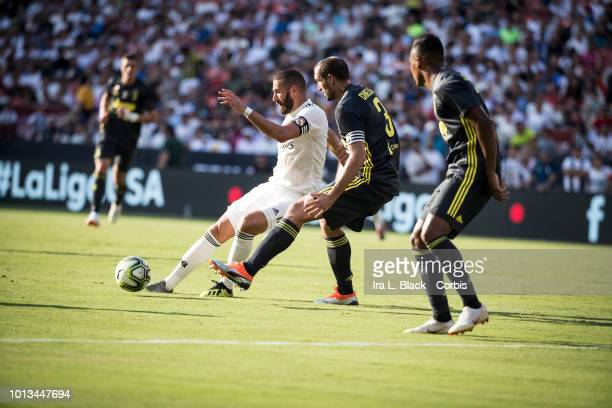 Karim Benzema of Real Madrid CF tries to get past Giorgio Chiellini of Juventus during the the International Champions Cup soccer match between...
