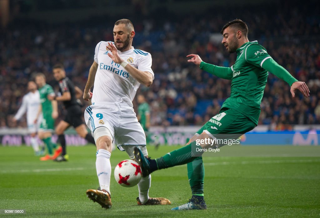 Karim Benzema of Real Madrid challenges Diego Rico of CD Leganes during the Copa del Rey, Quarter Final, Second Leg match between Real Madrid and Leganes at the Santiago Bernabeu stadium on January 24, 2018 in Madrid, Spain.