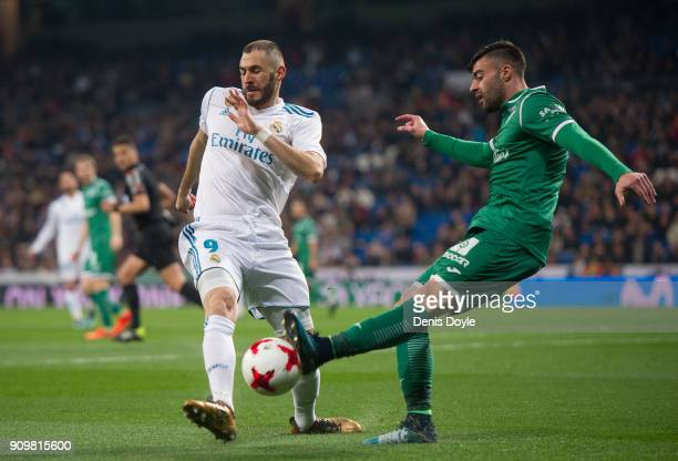 Karim Benzema of Real Madrid challenges Diego Rico of CD Leganes during the Copa del Rey Quarter Final Second Leg match between Real Madrid and...