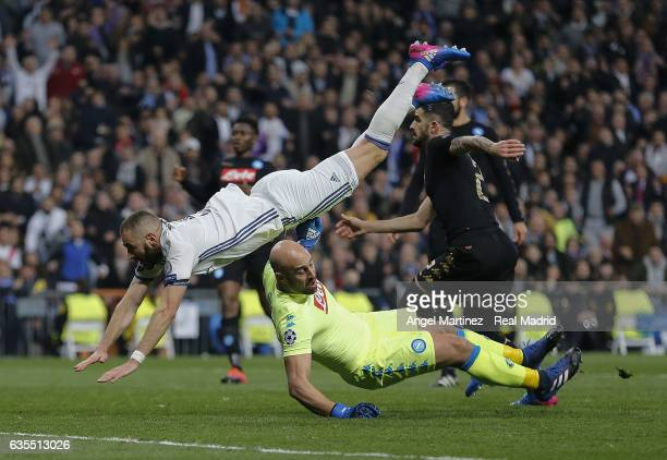 Karim Benzema of Real Madrid clashes with Pepe Reina of SSC Napoli during the UEFA Champions League Round of 16 first leg match between Real Madrid...