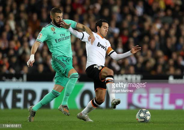 Karim Benzema of Real Madrid competes for the ball with Dani Parejo of Valencia during the Liga match between Valencia CF and Real Madrid CF at...