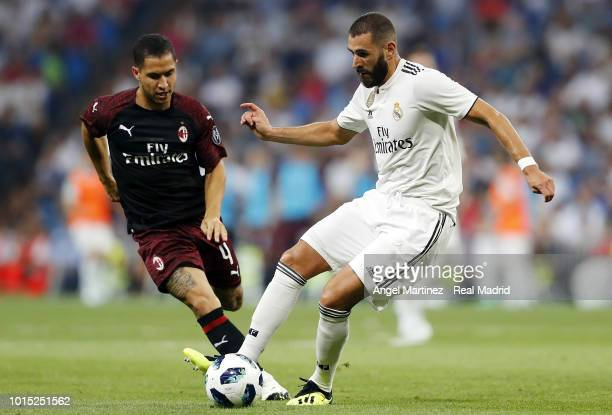 Karim Benzema of Real Madrid competes for the ball with Jose Mauri of AC Milan during the Trofeo Santiago Bernabeu match between Real Madrid and AC...
