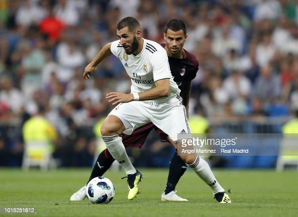 Karim Benzema of Real Madrid competes for the ball with Suso of AC Milan during the Trofeo Santiago Bernabeu match between Real Madrid and AC Milan...