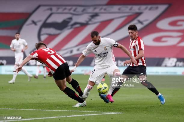 Karim Benzema of Real Madrid controls the ball during the La Liga Santander match between Athletic Club and Real Madrid at Estadio de San Mames on...