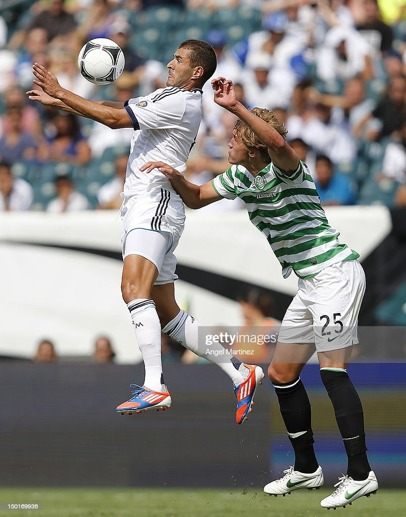Karim Benzema of Real Madrid controls the ball in front of Thomas Rogne of Celtic during a World Football Challenge match between Celtic and Real Madrid at at Lincoln Financial Field on August 11, 2012 in Philadelphia, Pennsylvania.