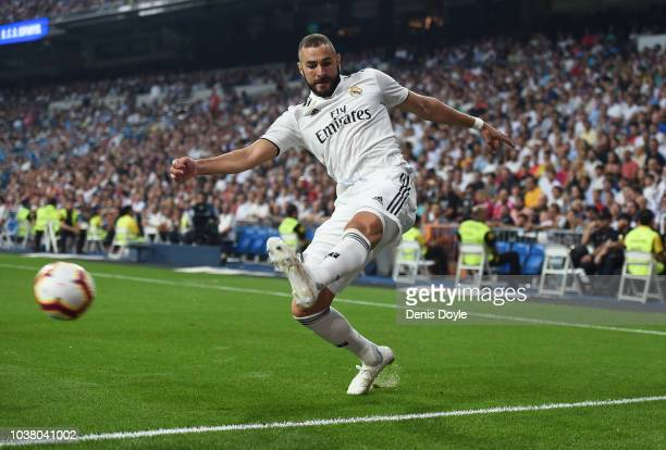 Karim Benzema of Real Madrid crosses the ball during the La Liga match between Real Madrid CF and RCD Espanyol at Estadio Santiago Bernabeu on...