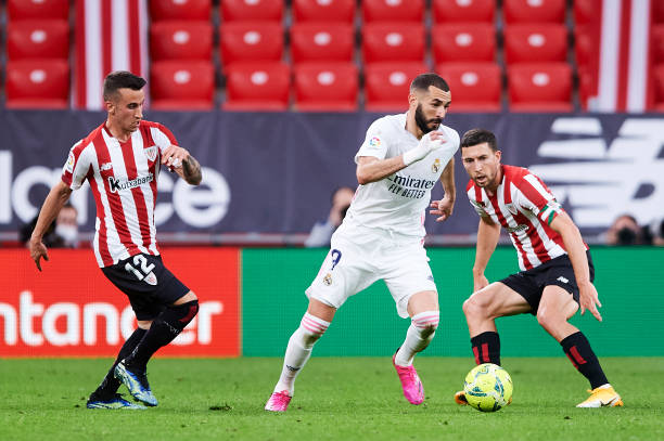 Karim Benzema of Real Madrid duels for the ball with Alejandro Berenguer of Athletic Club during the La Liga Santander match between Athletic Club...