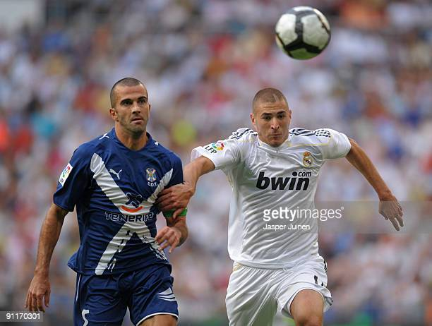 Karim Benzema of Real Madrid duels for the ball with Manuel Martinez of Tenerife during the La Liga match between Real Madrid and Tenerife at the...