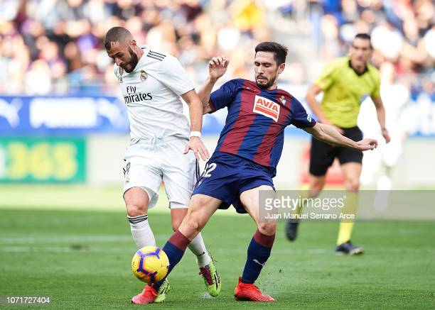 Karim Benzema of Real Madrid duels for the ball with Paulo Oliveira of SD Eibar during the La Liga match between SD Eibar and Real Madrid CF at...