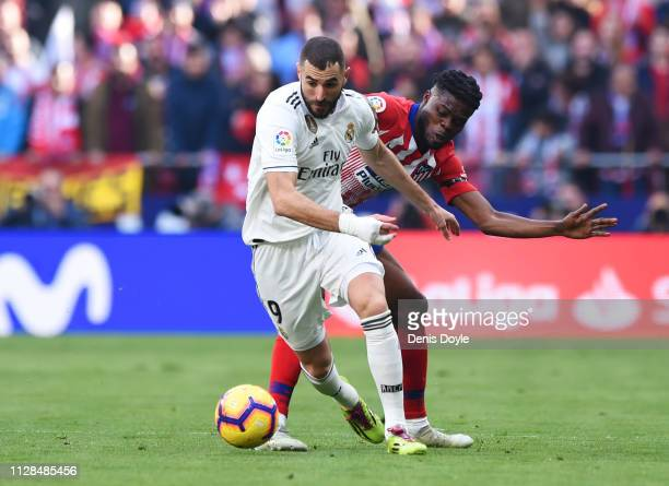 Karim Benzema of Real Madrid evades Thomas Partey of Atletico Madrid during the La Liga match between Club Atletico de Madrid and Real Madrid CF at...