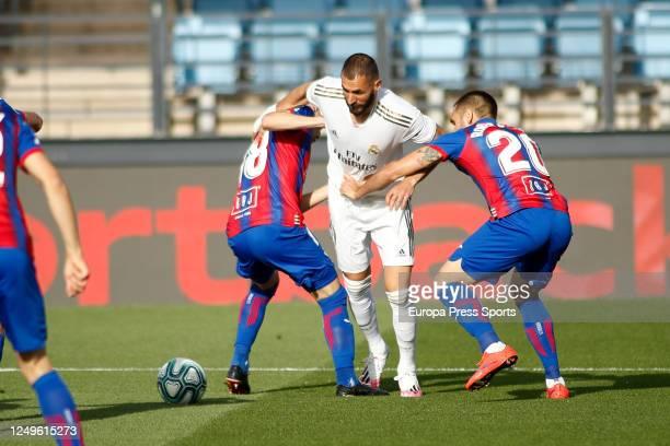 Karim Benzema of Real Madrid fight for the ball with Sebastian Cristoforo and Roberto Correa of Eibar during the La Liga football match between Real...