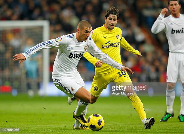 Karim Benzema of Real Madrid fights for the ball with Cani of Villarreal during the La Liga match between Real Madrid and Villarreal at Estadio...
