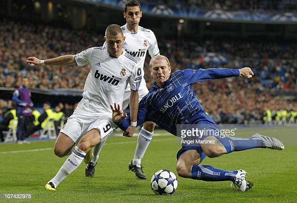Karim Benzema of Real Madrid fights for the ball with Stephane Grichting of AJ Auxerre during the Champions League group G match between Real Madrid...