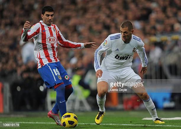 Karim Benzema of Real Madrid gets past Jose Antonio Reyes of Atletico Madrid during the La Liga match at Estadio Santiago Bernabeu on November 7 2010...