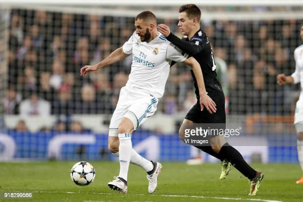 Karim Benzema of Real Madrid Giovani Lo Celso of Paris SaintGermain during the UEFA Champions League round of 16 match between Real Madrid and Paris...