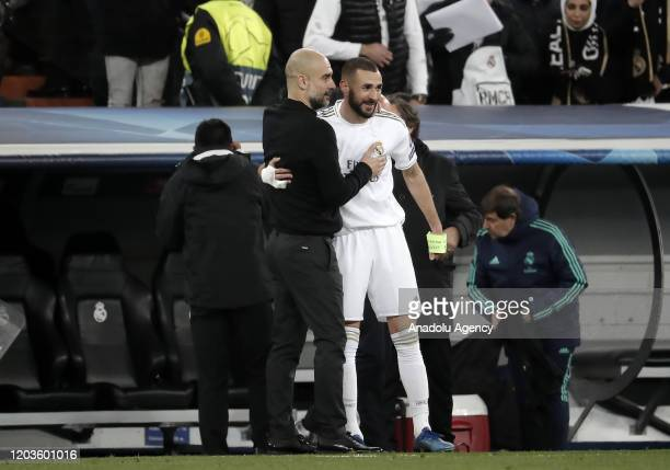 Karim Benzema of Real Madrid greets head coach of Manchester City Pep Guardiola during the UEFA Champions League round of 16 first leg soccer match...