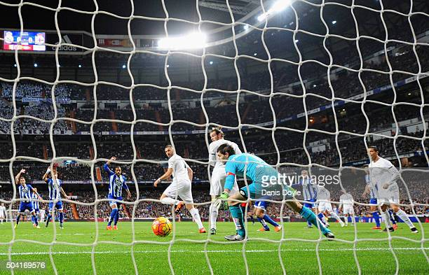 Karim Benzema of Real Madrid he scores their first goal past goalkeeper German Lux of Deportivo La Coruna during the La Liga match between Real...