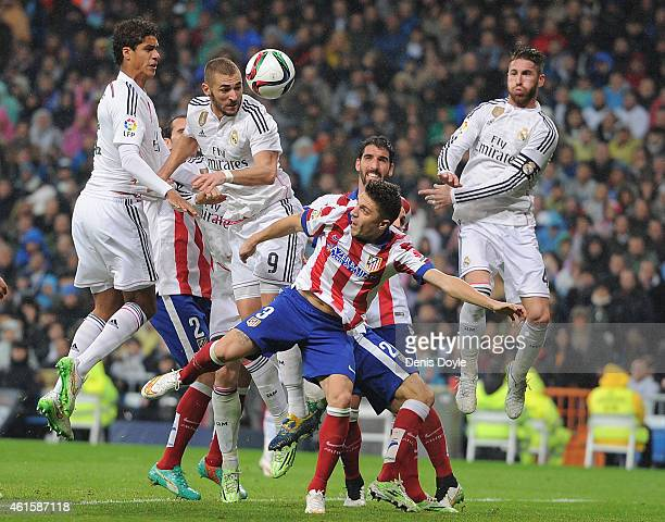Karim Benzema of Real Madrid heads the ball against Guilherme Siqueira of Atletico de Madrid during the Copa del Rey Round of 16 Second leg match...