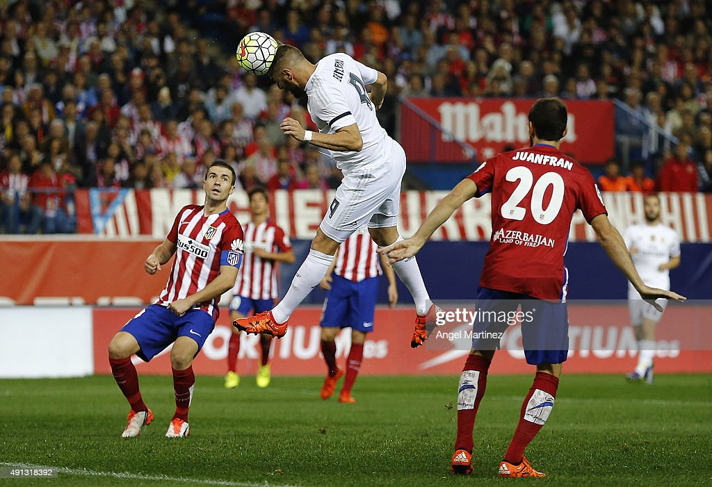 Karim Benzema of Real Madrid heads the ball to score the opening goal during the La Liga match between Club Atletico de Madrid and Real Madrid CF at Vicente Calderon Stadium on October 4, 2015 in Madrid, Spain.