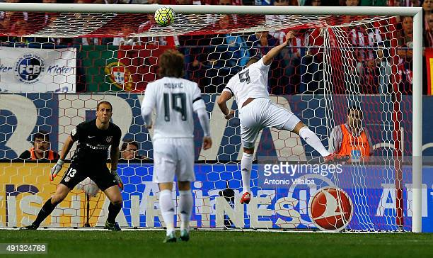 Karim Benzema of Real Madrid heads the ball to score the opening goal during the La Liga match between Club Atletico de Madrid and Real Madrid CF at...