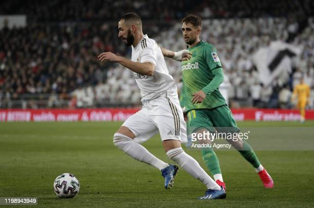 Karim Benzema of Real Madrid in action against Adnan Januzaj of Real Sociedad during the Spanish Copa del Rey match between Real Madrid and Real...