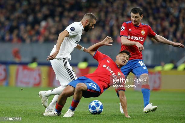 Karim Benzema of Real Madrid in action against Alan Dzagoev of CSKA Moscow during UEFA Champions League Group G soccer match between CSKA Moscow and...