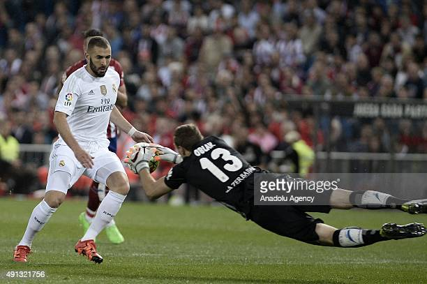 Karim Benzema of Real Madrid in action against Atletico Madrid's goalkeeper Jan Oblak during the Spanish La Liga football match between Atletico...