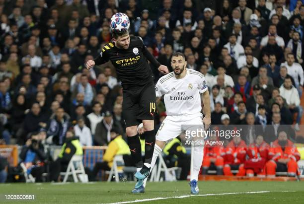 Karim Benzema of Real Madrid in action against Aymeric Laporte of Manchester City during the UEFA Champions League round of 16 first leg soccer match...