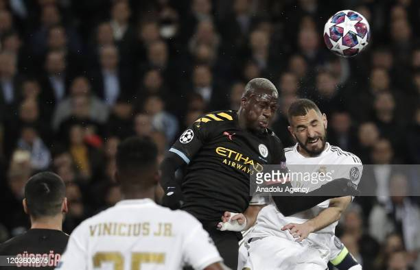 Karim Benzema of Real Madrid in action against Benjamin Mendy of Manchester City during the UEFA Champions League round of 16 first leg soccer match...