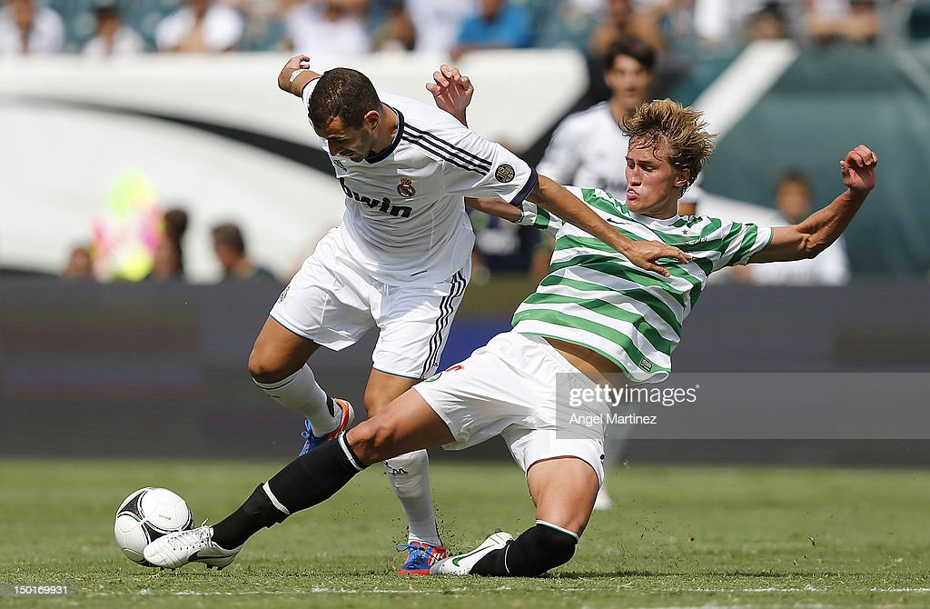 Karim Benzema of Real Madrid is challenged by Thomas Rogne of Celtic during a World Football Challenge match between Celtic and Real Madrid at at Lincoln Financial Field on August 11, 2012 in Philadelphia, Pennsylvania.