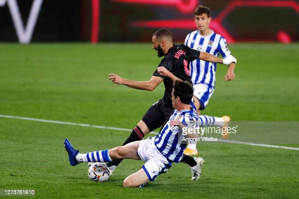 Karim Benzema of Real Madrid is challenged during the La Liga Santander match between Real Sociedad and Real Madrid at Estadio Anoeta on September 20...