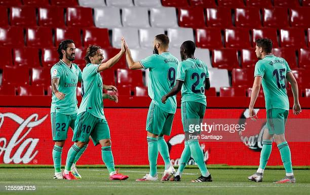 Karim Benzema of Real Madrid is congratulated after scoring the teams second goal during the Liga match between Granada CF and Real Madrid CF at on...