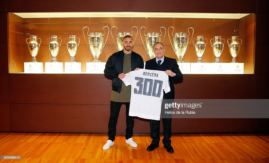 Karim Benzema (L) of Real Madrid is presented with a shirt to commemorate his 300th appearance by Real Madrid President Florentino Perez after the La Liga match ween Real Madrid CF and Real Sportin de Gijon at Estadio Santiago Bernabeu on January 17, 2016 in Madrid, Spain.