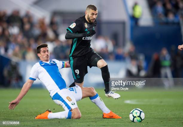 Karim Benzema of Real Madrid is tackled by Gabriel Pires of CD Leganes during the La Liga match between Leganes and Real Madrid at Estadio Municipal...