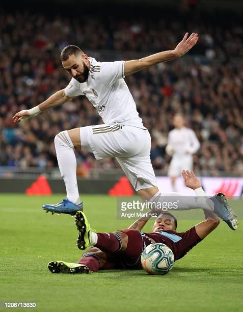 Karim Benzema of Real Madrid is tackled by Jeison Murillo of Celta Vigo during the La Liga match between Real Madrid CF and RC Celta de Vigo at...