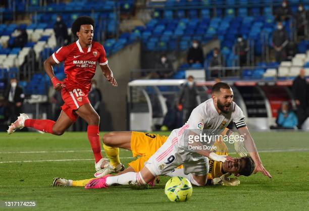 Karim Benzema of Real Madrid is tackled by Yassine Bounou ''Bono'' of Sevilla FC during the La Liga Santander match between Real Madrid and Sevilla...