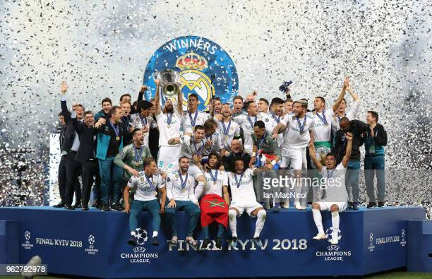 Karim Benzema of Real Madrid lifts the trophy during the UEFA Champions League final between Real Madrid and Liverpool on May 26 2018 in Kiev Ukraine