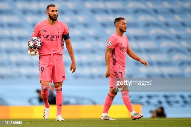 Karim Benzema of Real Madrid looks dejected after his team concede during the UEFA Champions League round of 16 second leg match between Manchester...