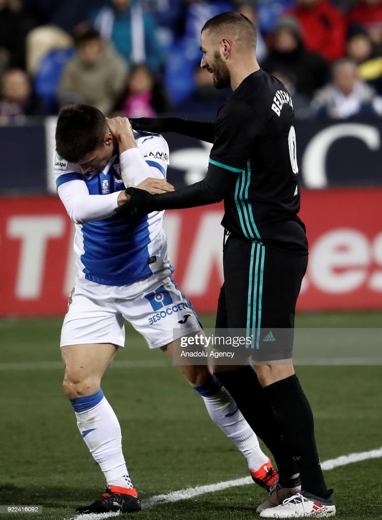 Karim Benzema of Real Madrid makes a joke to Unai Bustinza of Leganes during the La Liga football match between Leganes and Real Madrid at the Estadio Municipal Butarque in Madrid, Spain on February 21, 2018.
