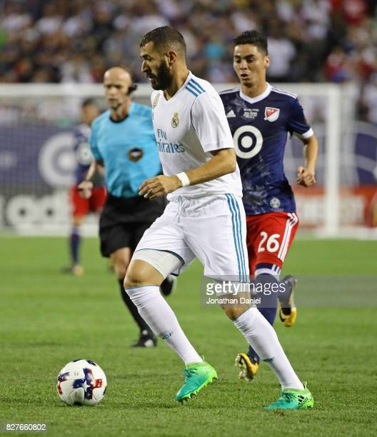 Karim Benzema of Real Madrid moves past Miguel Almiron of the MLS AllStars during the 2017 MLS All Star Game at Soldier Field on August 2 2017 in...