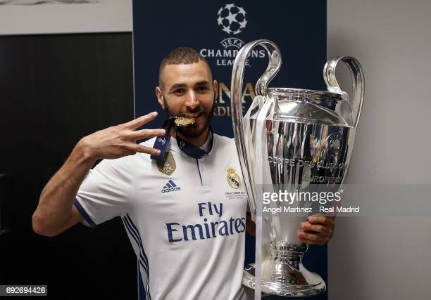 Karim Benzema of Real Madrid poses with the Champions League trophy after the UEFA Champions League Final match between Juventus and Real Madrid at...